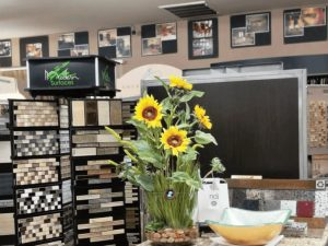 design center product lines and samples with bouquet of sunflowers